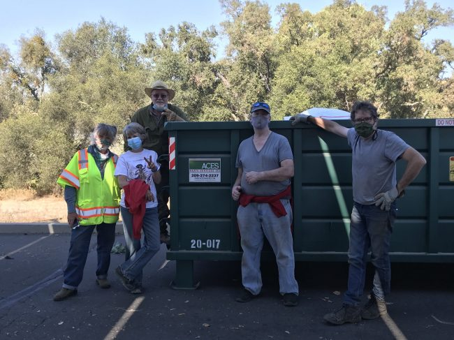 FC Volunteers Pose by Dumpster after Jackson Creek Encampment Cleanup 2020
